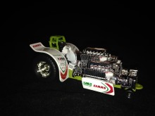 1/64 Claas Green Monster Pulling Tractor